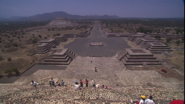 tourists gather at the pre-columbian  pyramid-temple archaeological site  at cholula, mexico. - pre columbian stock videos & royalty-free footage