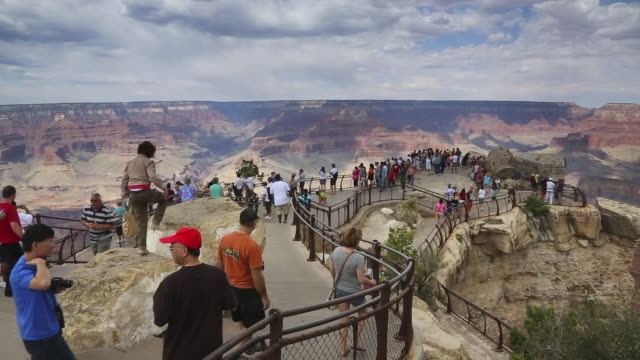 tourists gather at yaki point in grand canyon national park. - grand canyon stock-videos und b-roll-filmmaterial