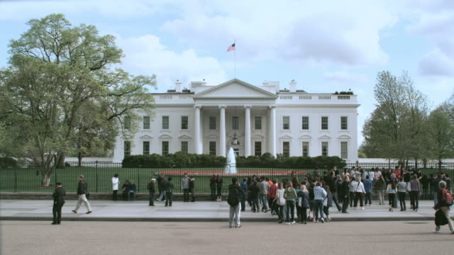 WS Tourists gathering at the fence in front of White House / Washington, District of Columbia, United States