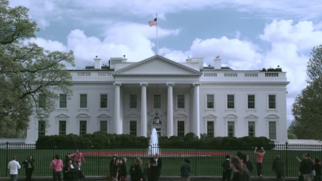 la tourists gathering at the fence in front of white house / washington, district of columbia, united states - 2000s style stock videos & royalty-free footage