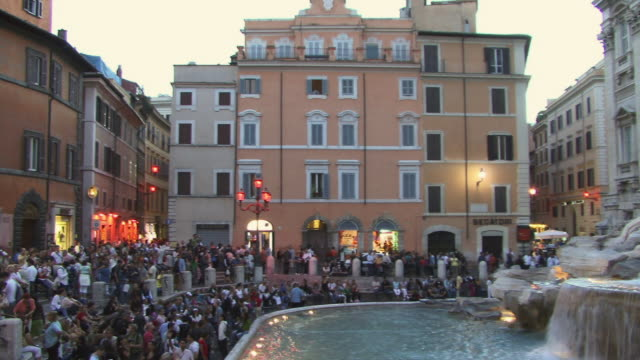 WS, PAN, Tourists gathering at Trevi Fountain at dusk, Rome, Italy