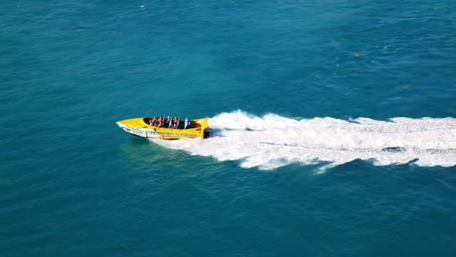 tourists go to the race boat excursion in saint thomas, virgin islands, carribean - モーターボート点の映像素材/bロール