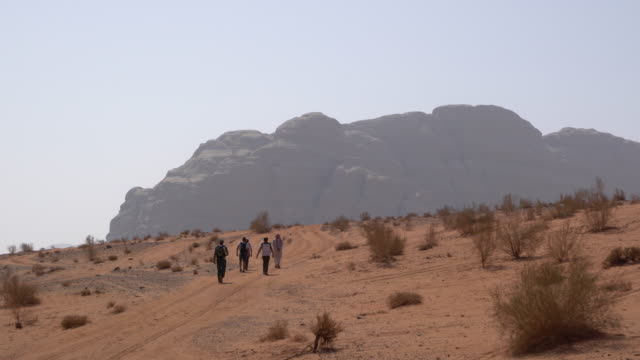 tourists hiking in wadi rum desert, jordan - granite rock stock videos and b-roll footage