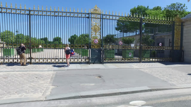 tourists in front of the gates of the closed tuileries garden parks and gardens in the city of paris remain closed even after may 11 the date of the... - three people stock videos & royalty-free footage