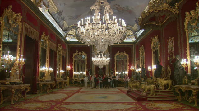 ws tourists in hall of royal palace, madrid, spain - palace video stock e b–roll