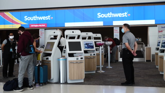 tourists in line to southwest airlines co. check-in counters at san francisco international airport in san francisco, california, u.s., on wednesday,... - san francisco international airport stock videos & royalty-free footage