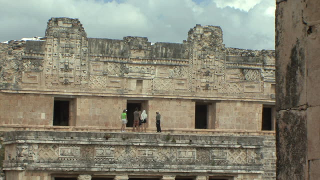 WS Tourists in North building of Nunnery Quadrangle at pre-Columbian ruined city of Maya civilization / Uxmal, Yucatan, Mexico