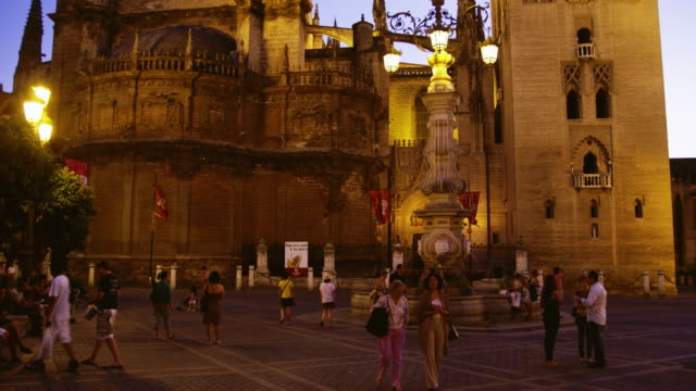 WS TU Tourists in Plaza del Triunfo outside Cathedral of Seville / Seville, Andalusia, Spain