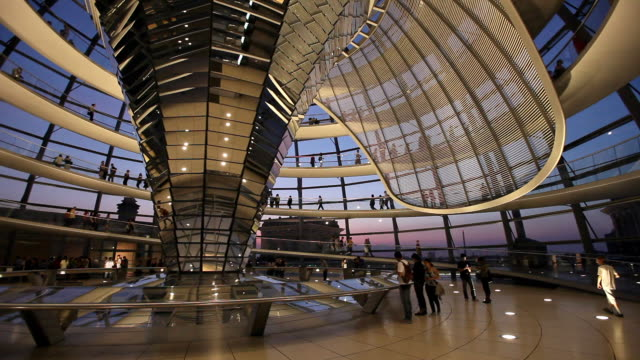 ws tourists in reichstag dome at dusk, berlin, germany - cupola video stock e b–roll