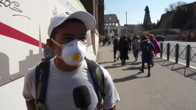 tourists in rome react to the latest news of the spread of the novel coronavirus in northern italy - report produced segment stock videos & royalty-free footage