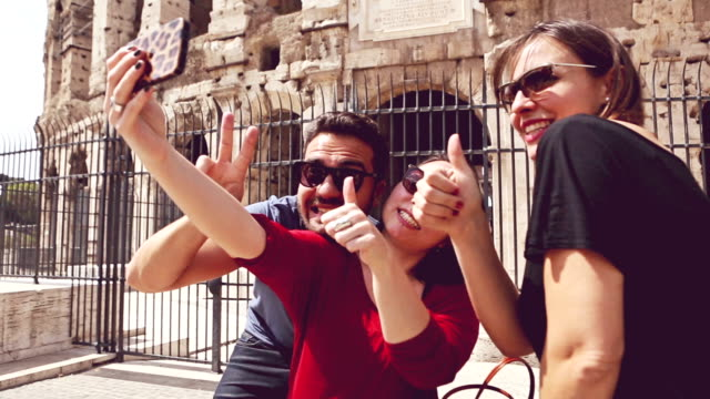 Tourists in Rome taking a selfie by Coliseum
