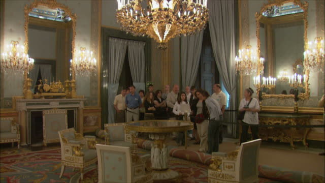 ws tu tourists in royal palace, madrid, spain - palast stock-videos und b-roll-filmmaterial