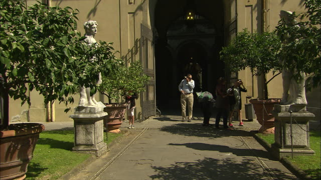 tourists in the courtyard, lucca, italy - female likeness stock videos & royalty-free footage
