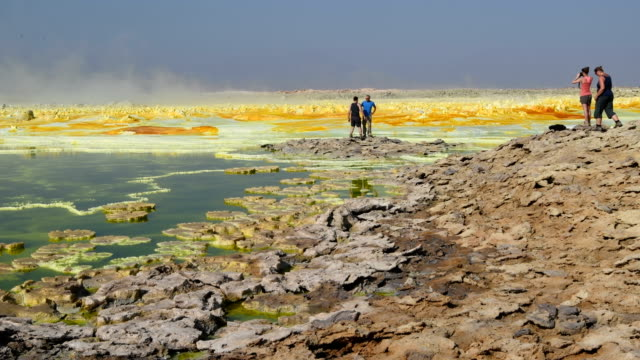 tourists in the danakil depression on january 22 2017 in dallol ethiopia the depression lies 100 metres below sea level and is one of the hottest and... - salt mineral stock videos & royalty-free footage
