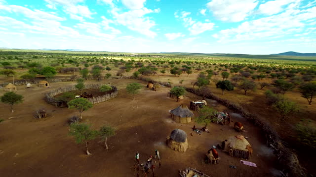 heli tourists in the himba village - remote location stock videos & royalty-free footage