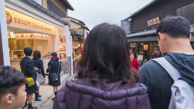 tourists in the historic old town walking to the kiyomizu-dera temple - fast motion stock videos & royalty-free footage
