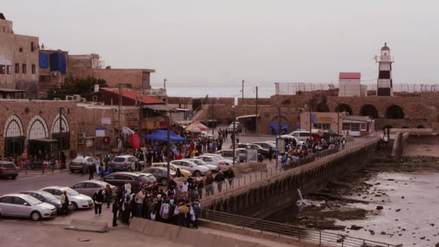tourists in the old city akko, israel, middle east - akko stock videos and b-roll footage