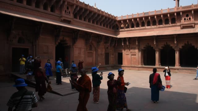 Tourists in the Red Fort at Agra, India.