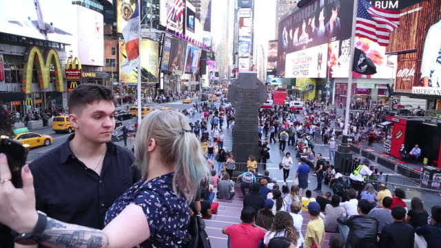 tourists in times square, new york, u.s. on monday, may 21, 2018. - internationell sevärdhet bildbanksvideor och videomaterial från bakom kulisserna