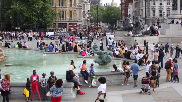 tourists in trafalgar square, london, uk. - fountain stock videos & royalty-free footage