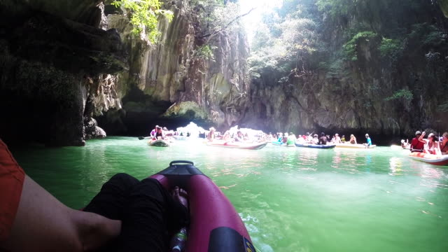 Tourists kayak near caves and limestone cliffs Khao Phing Kan is also referred to as 'James Bond Island'