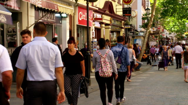 tourists & locals shop or stroll on Gibraltar's Main Street