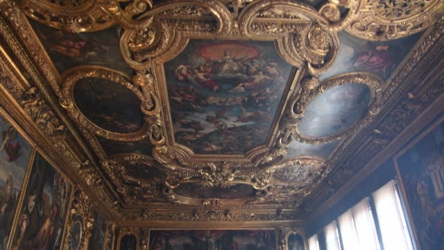tourists look at paintings on the ceilings at the doge's palace during the coronavirus pandemic on june 13, 2020 in venice, italy. the whole country... - palace stock-videos und b-roll-filmmaterial