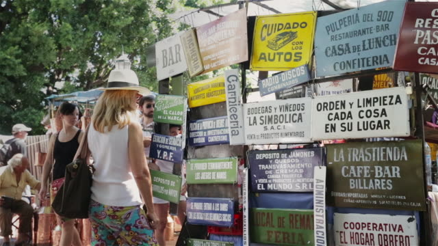 ms tourists look at the antique market in san telmo / buenos aires, argentina - san telmo stock videos & royalty-free footage