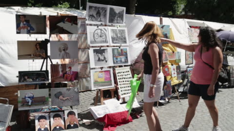 ms tourists look at the market in san telmo / buenos aires, argentina - latin america stock videos & royalty-free footage