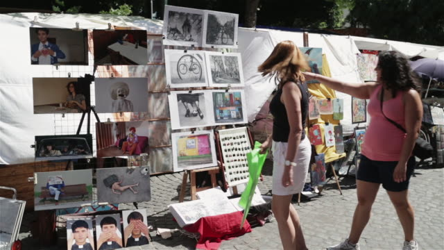 ms tourists look at the market in san telmo / buenos aires, argentina - drawing art product stock videos & royalty-free footage