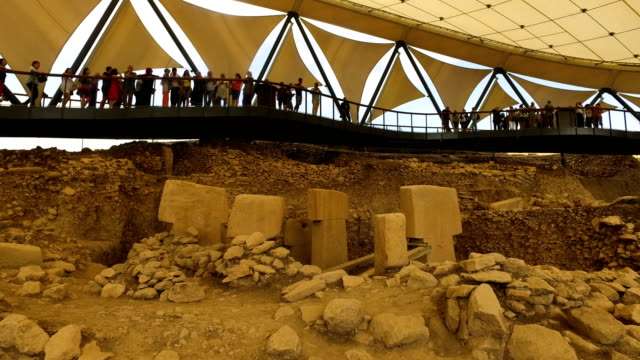 Tourists look over TShaped pillars at the Gobekli Tepe archaeology site on September 18 2018 in Sanliurfa Turkey Since it's discovery The 'Gobekli...