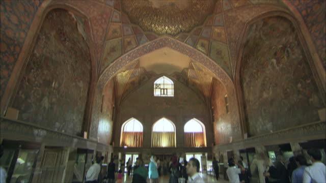 WS TU TD Tourists looking at decorated ceiling at Chehel Sotoun pavilion, Isfahan, Iran
