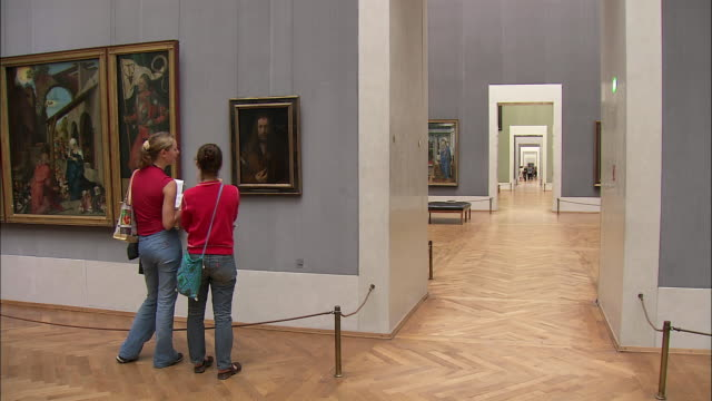 ws pan tourists looking at durer's paintings in alte pinakothek, munich, bavaria, germany - renaissance stock-videos und b-roll-filmmaterial