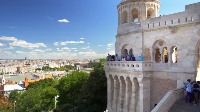 tourists looking at view in budapest fisherman's bastion - budapest video stock e b–roll