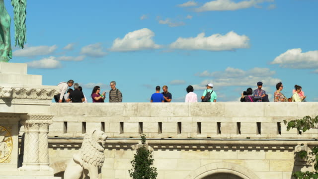 tourists looking at view on budapest fishermen's bastion - traditionally hungarian stock videos & royalty-free footage