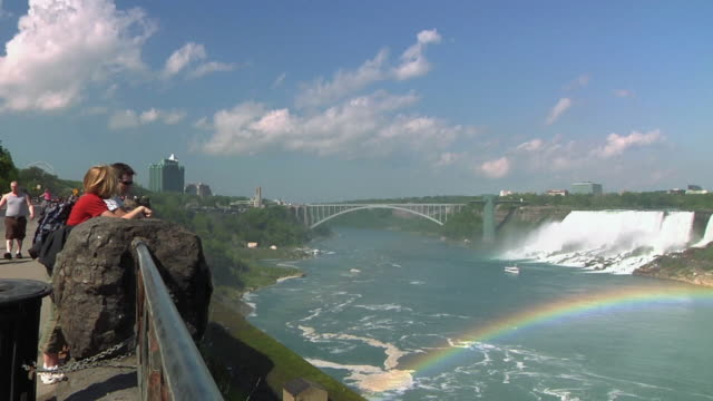 ws tourists looking out from viewing platform toward niagara falls / toronto, ontario, canada - fluss niagara river stock-videos und b-roll-filmmaterial