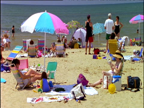 tourists lounging on first encounter beach cape cod - outdoor chair stock videos & royalty-free footage