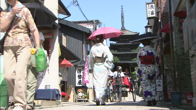 Tourists move through an alley near Yasaka Pagoda.