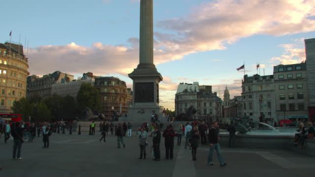 london - october 7: tourists near nelson's column in trafalgar square at sundown on october 7, 2011 in london. - nelson's column stock videos & royalty-free footage