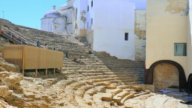 tourists observing roman theater in cadiz - römisch stock-videos und b-roll-filmmaterial