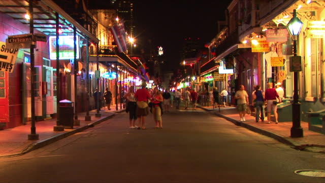 t/l ws tourists on bourbon street at night, french quarter, new orleans, louisiana, usa - bourbon street new orleans stock videos and b-roll footage