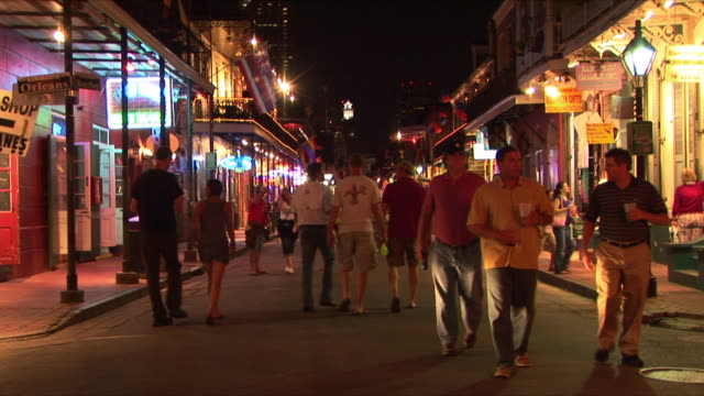ws tourists on bourbon street at night, french quarter, new orleans, louisiana, usa - bourbon street new orleans stock videos and b-roll footage