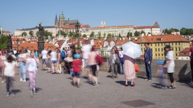 tourists on charles bridge - charles bridge stock videos & royalty-free footage