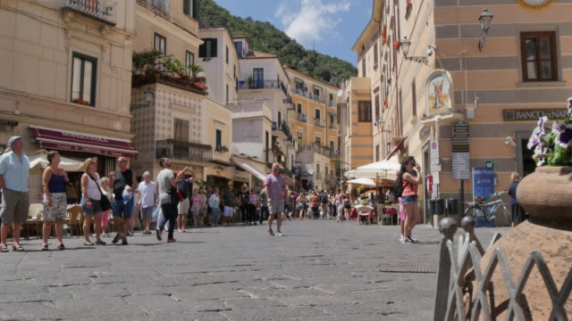 tourists on duomo piazza, amalfi, costiera amalfitana (amalfi coast), unesco world heritage site, campania, italy, europe - amalfi stock videos and b-roll footage