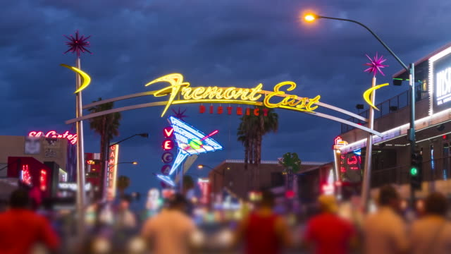 Tourists on Fremont street in Las Vegas, Nevada at night, timelapse (people blurred for commercial use)