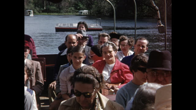 stockvideo's en b-roll-footage met 1954 home movie tourists on jungle cruise boat at cypress gardens / winter haven, florida  - 50 59 jaar