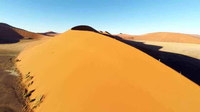 heli tourists on namibian sand dunes - namibian desert stock videos and b-roll footage