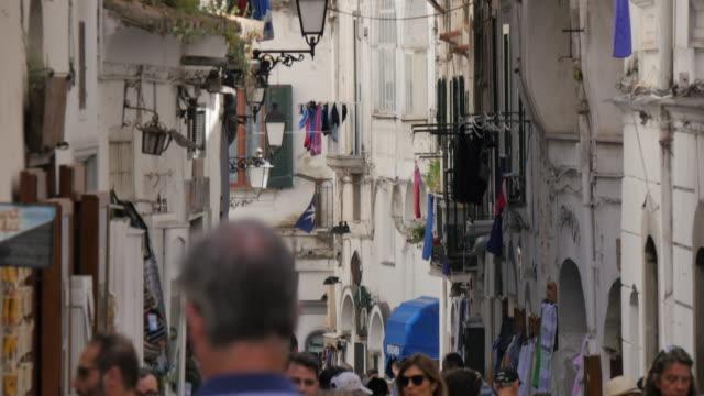 tourists on narrow street near duomo piazza, amalfi, costiera amalfitana (amalfi coast), unesco world heritage site, campania, italy, europe - amalfi stock videos and b-roll footage