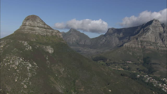 aerial zi tourists on peak of lion's head, table mountain in background, cape town, western cape, south africa - lion's head mountain stock videos and b-roll footage