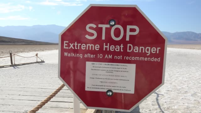 tourists on salt pans badwater in death valley which is the lowest, hottest, driest place in the usa, with an average annual rainfall of around 2... - death valley national park stock videos & royalty-free footage